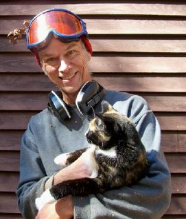 Chainsaw-toting warrior Joe with his cat Marigold.